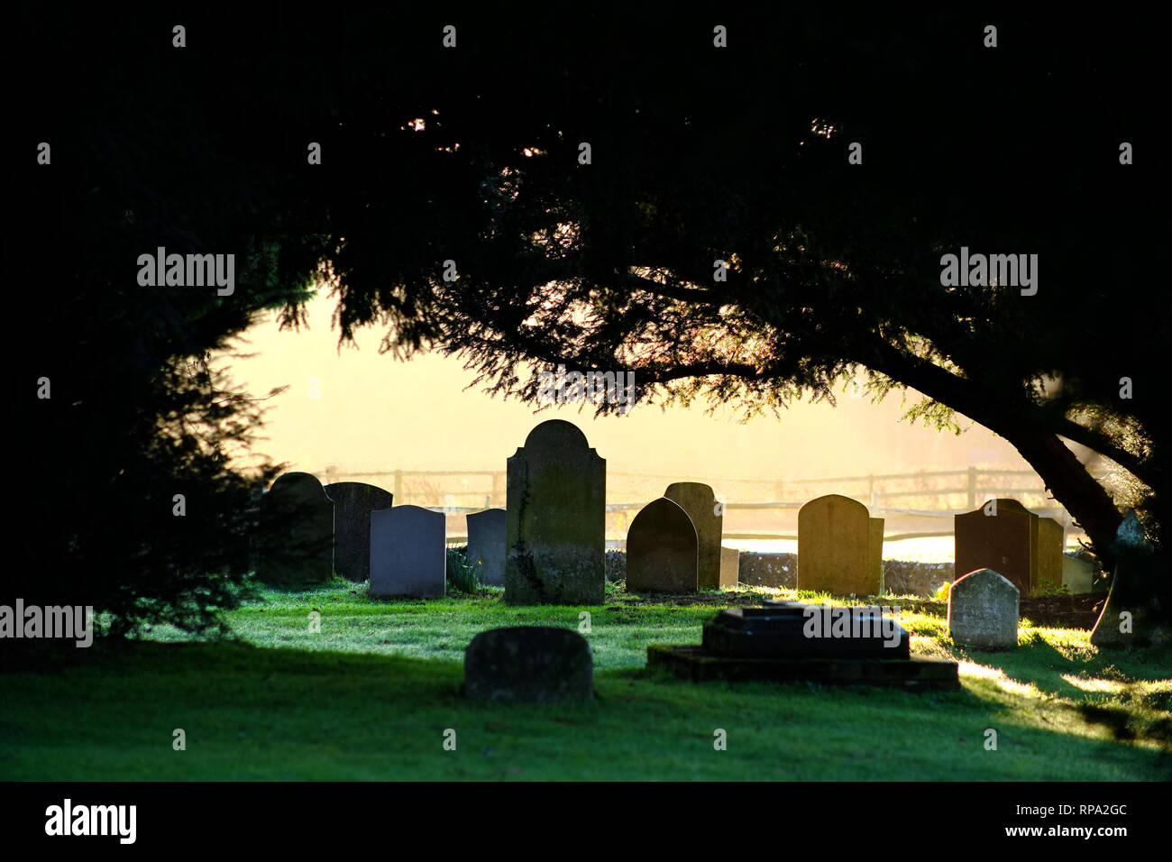 Graves in a village churchyard. - Stock Image