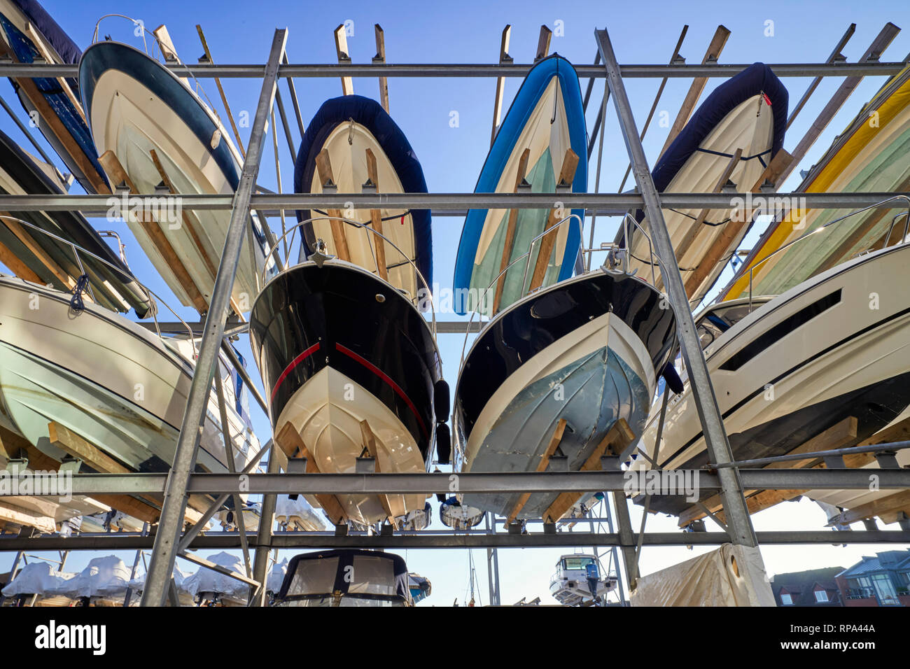 Pleasure boats parked on a vertical rack system at Camber Dock in Portsmouth - Stock Image