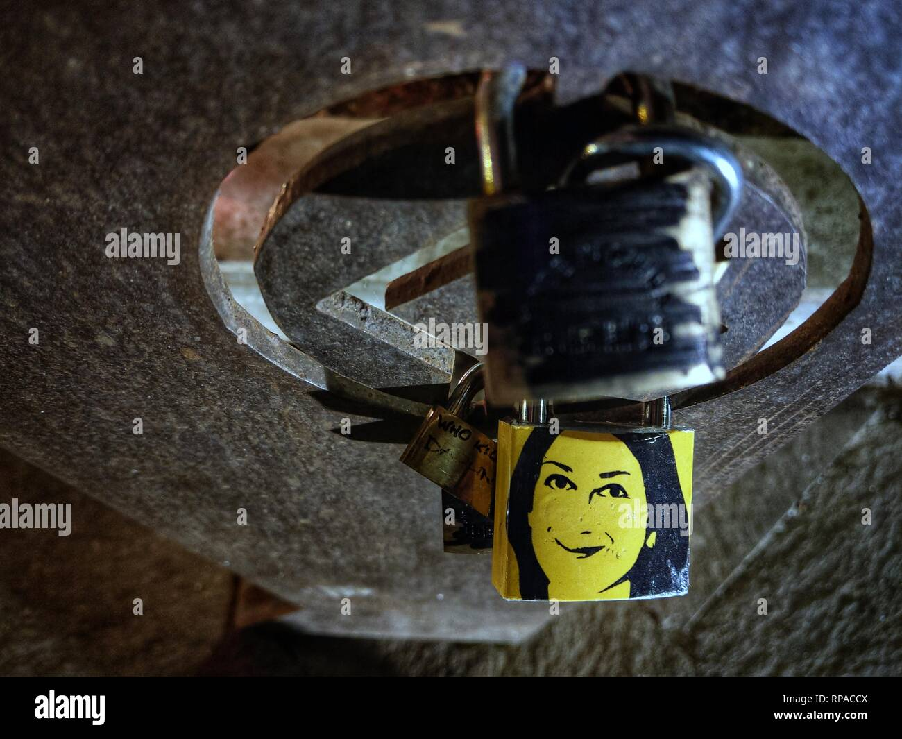 February 21, 2019 - Valletta, Malta - The image of murdered journalist Daphne Caruana Galizia on a lock at the Siege Memorial in Valletta, Malta. (Credit Image: © Sachelle Babbar/ZUMA Wire) - Stock Image