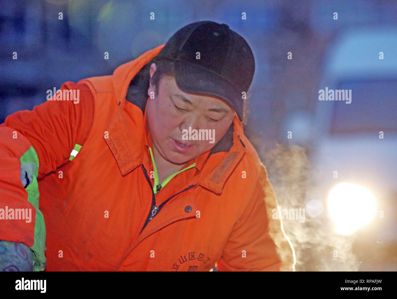 (190221) -- ANSHAN, Feb. 21, 2019 (Xinhua) -- Zhuang Yan, deputy to the 13th National People's Congress(NPC), cleans a street in the Lishan District in Anshan, northeast China's Liaoning Province, Feb. 12, 2019. Zhuang Yan, 47, is a sanitation worker with Hengjie Sanitation Company in the Lishan District of Anshan city.     In addition to performing well in her own work, Zhuang always thinks about how to better play her role as an NPC deputy.      Whenever she goes to a northern city, Zhuang pays much attention to local curbs and their corrosion degree. Based on her research, Zhuang proposed t - Stock Image