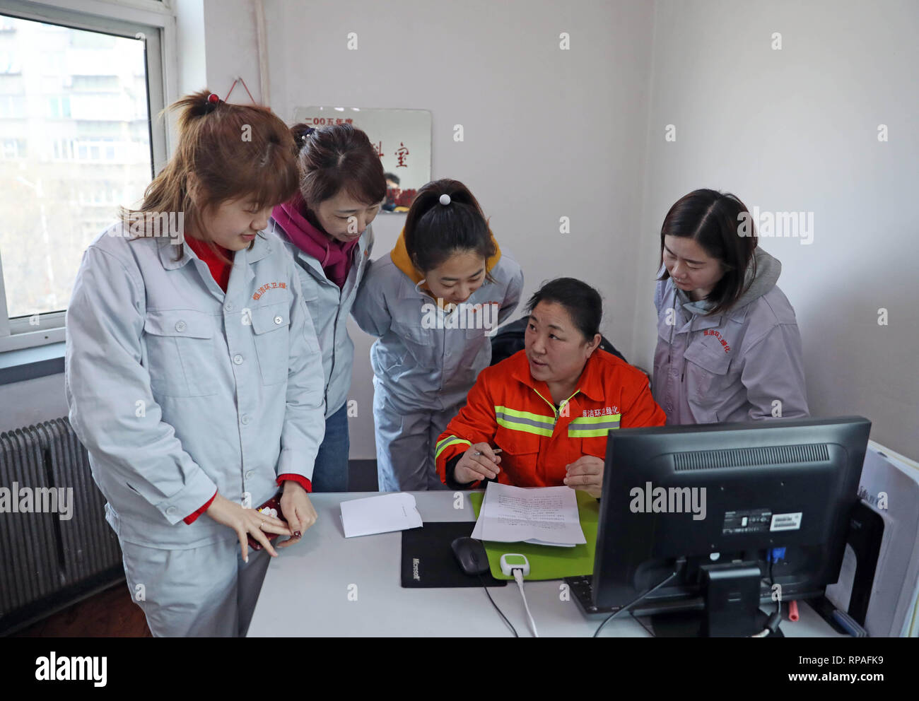 (190221) -- ANSHAN, Feb. 21, 2019 (Xinhua) -- Zhuang Yan (2nd R), deputy to the 13th National People's Congress (NPC), takes notes of her colleagues' suggestions in Anshan, northeast China's Liaoning Province, Feb. 12, 2019. Zhuang Yan, 47, is a sanitation worker with Hengjie Sanitation Company in the Lishan District of Anshan city.     In addition to performing well in her own work, Zhuang always thinks about how to better play her role as an NPC deputy.      Whenever she goes to a northern city, Zhuang pays much attention to local curbs and their corrosion degree. Based on her research, Zhua - Stock Image