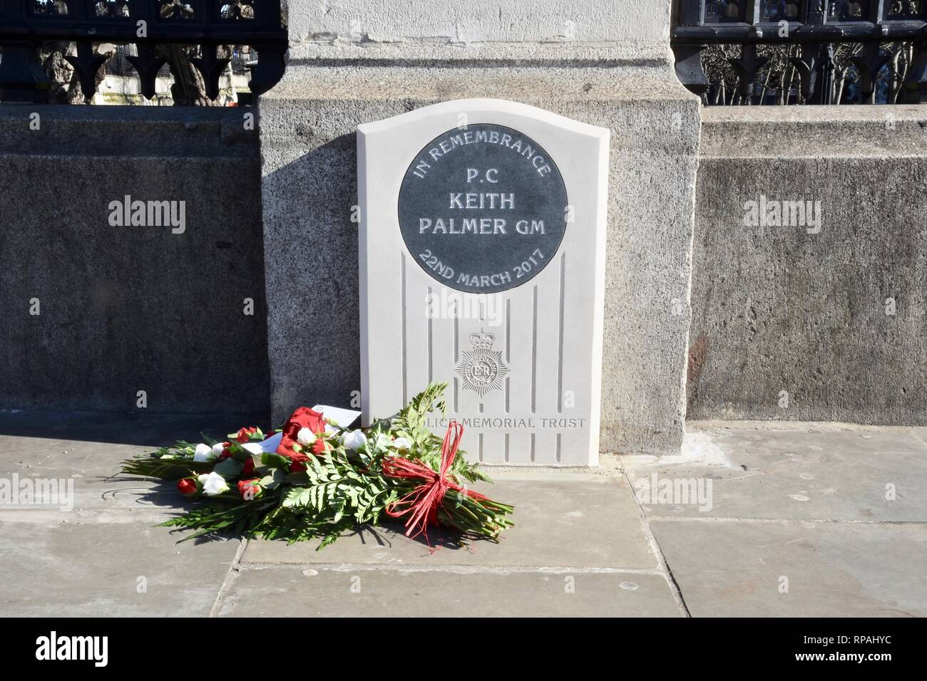 21st Feb 2019. Memorial to PC Keith Palmer who was killed in the Westminster Bridge Terror Attack.Carriage Gates,Houses of Parliament, Westminster, London.UK Credit: michael melia/Alamy Live News - Stock Image