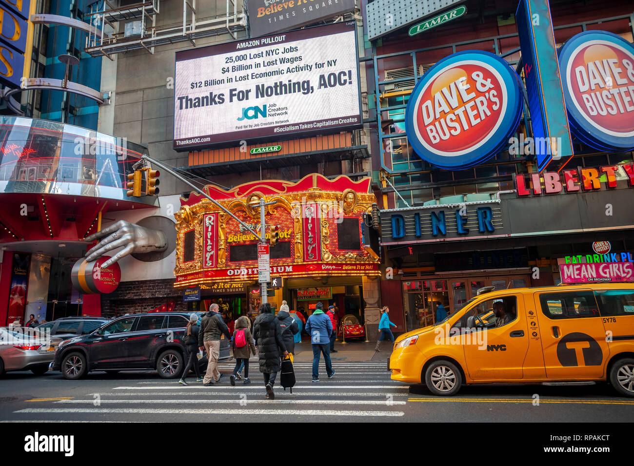 New York, USA. 21st Feb 2019. An electronic billboard in Times Square in New York on Thursday, February 21, 2019 chastises Alexandria Ocasio-Cortez (AOC) (D-NY) for squashing the deal between New York City and Amazon to build HQ2 in Long Island City. The Job Creators Network advocates for less government involvement in businesses and the lowering of taxes with a Conservative agenda. Ocasio-Cortez was one of numerous politicians opposed to the deal which was not in her district.(© Richard B. Levine) Credit: Richard Levine/Alamy Live News - Stock Image