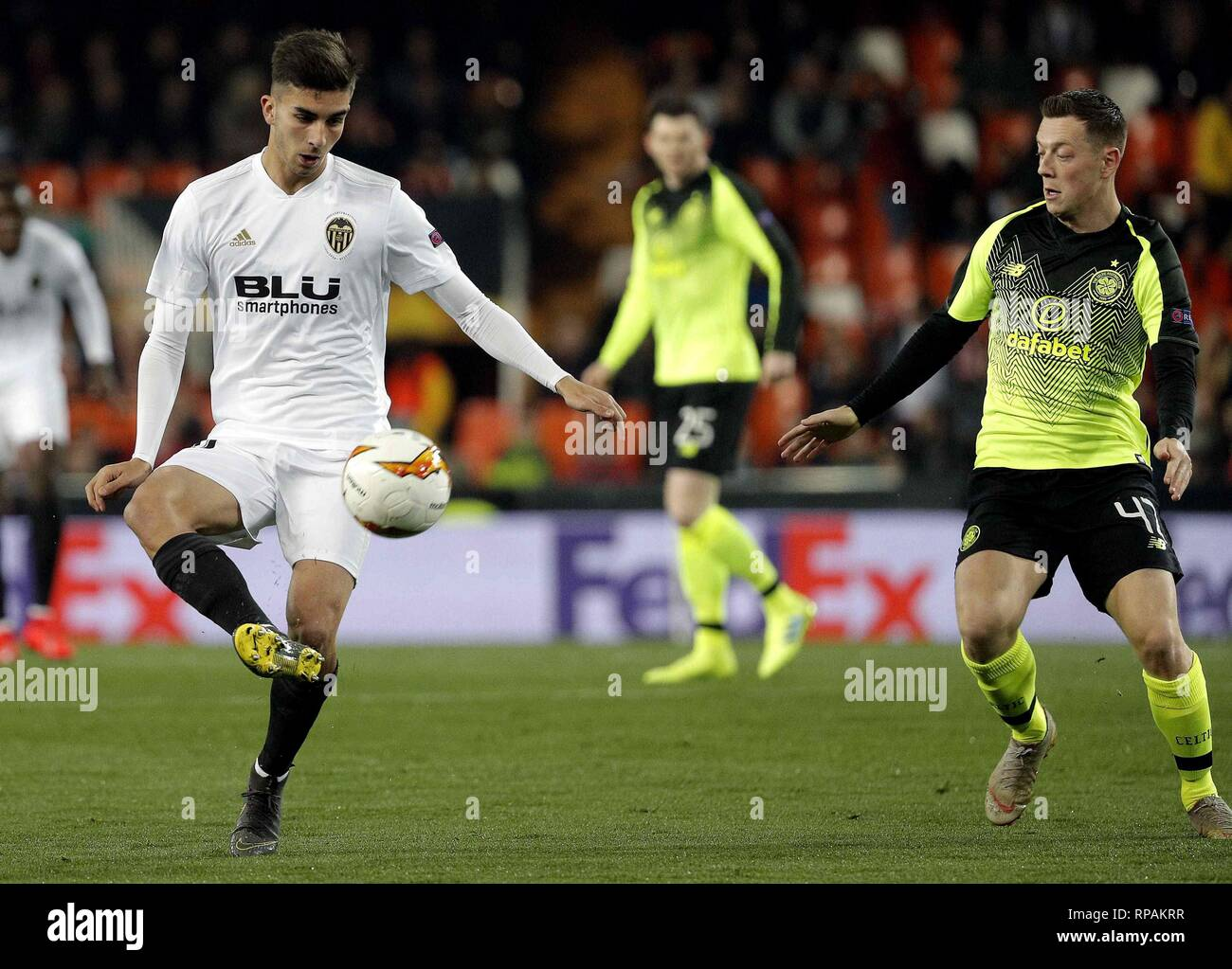 Valencia CF's Ferran Torres (L) in action against Celtic Glasgow's Callum Mcgregor (R) during a UEFA Europa League round of 32, second leg soccer match between Valencia CF and Celtic Glasgow at Mestalla stadium in Valencia, eastern Spain, 21 February 2019. EFE/ Manuel Bruque - Stock Image