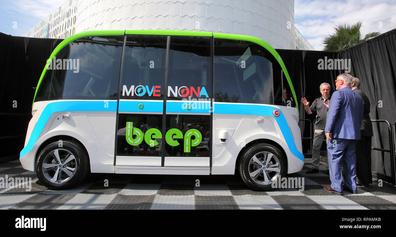 JEROME RIGAUD (left), CEO of NAVYA, a global leader in autonomous vehicles, shows Orlando Mayor BUDDY DYER and JERRY DEMINGS, Orange County mayor, the Beep AUTONOM Shuttle during a ceremony at Lake Nona Town Center. The Beep shuttle will be Central Florida's first autonomous public transit and is expected to begin service later this year. - Stock Image