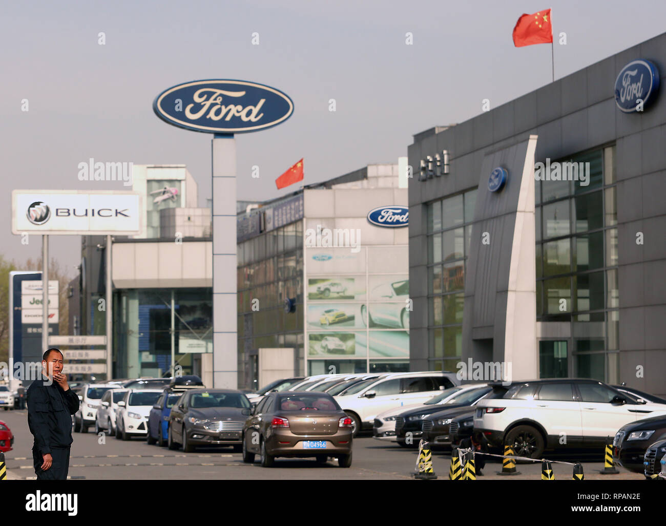 April 8, 2018 - Beijing, China - Chinese national flags fly over Ford and Buick showrooms in Beijing on April 8, 2018.  China hit back at the U.S. with proposed tariffs on $50 billion worth of goods - American cars, soybeans, whiskey and other goods.. (Credit Image: © Todd Lee/ZUMAprilESS.com/ZUMA Wire) Stock Photo