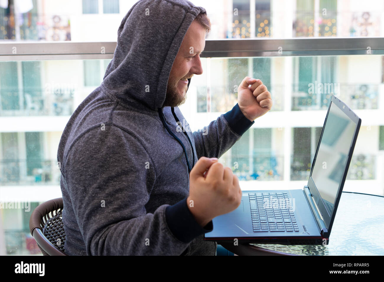 Cybercrime, hacking and technology concept - male hacker