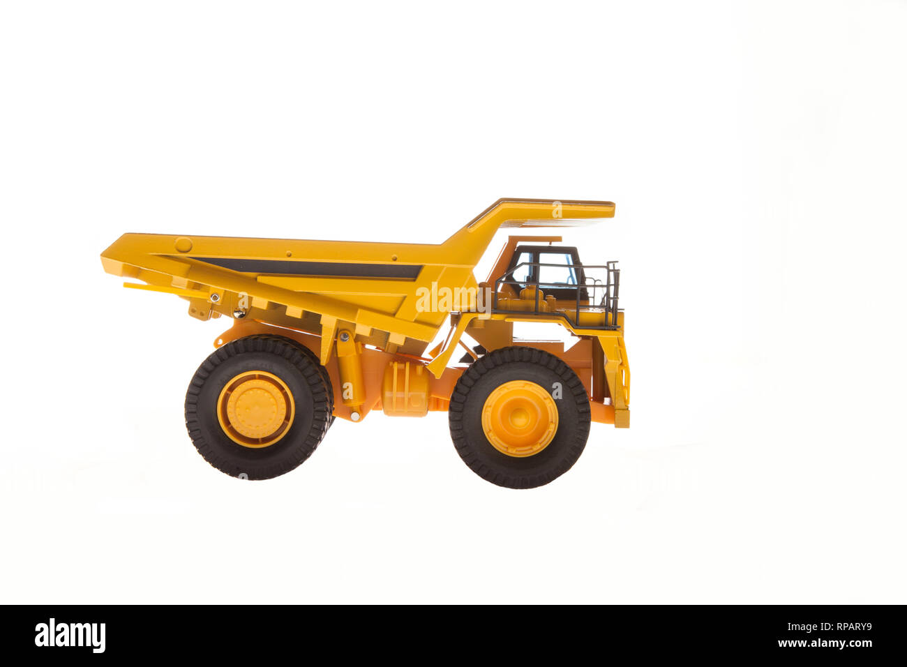 Heavy Load Dump Truck Carrier Side View - Stock Image