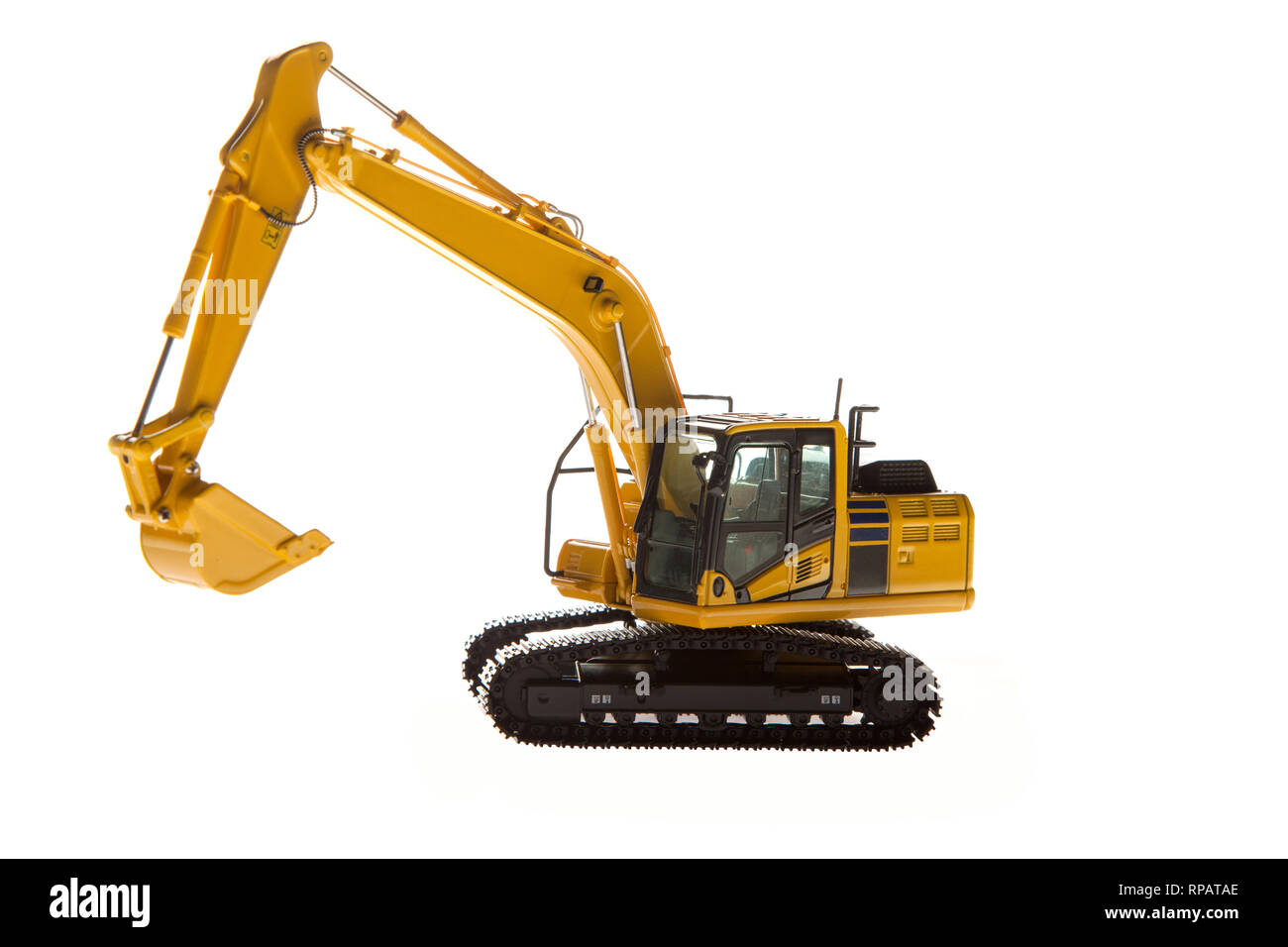 Excavator construction machinery front angle - Stock Image