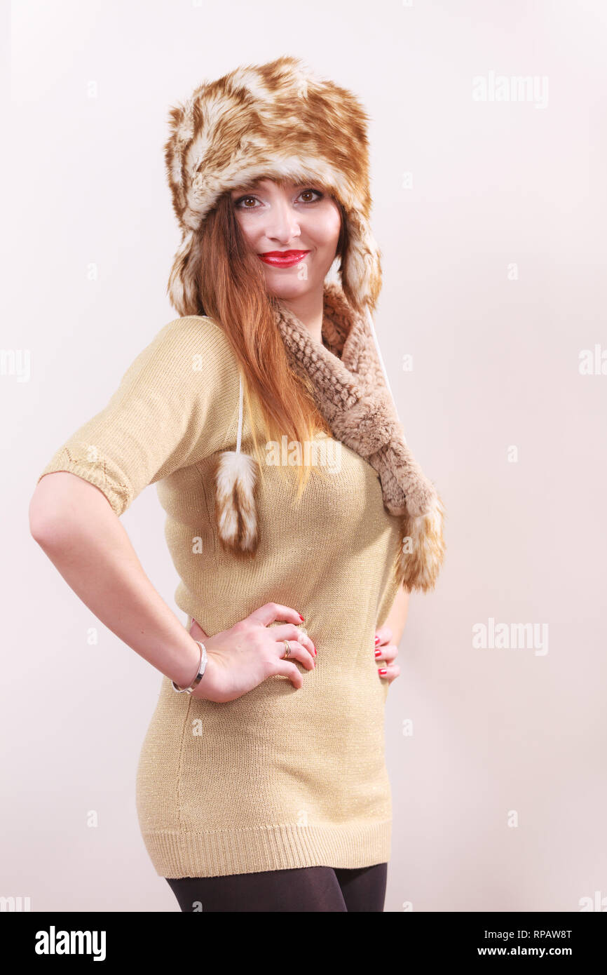 a0100b122f6 Winter fashion. Young woman wearing fashionable wintertime clothes fur cap  woolen sweater studio shot on