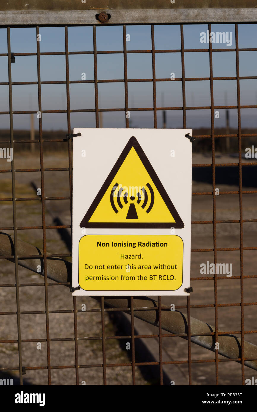Non ionising radiation warning sign outside a BT microwave transmitter station - Stock Image