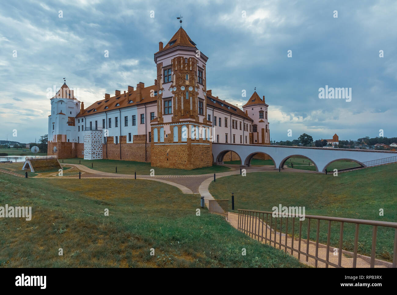 Mir Castle in Belarus cultural heritage and architecture, summer landscape with a cloudy sky - Stock Image