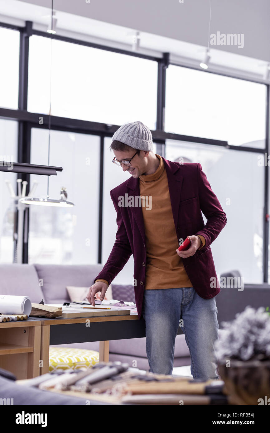 Nice Looking Fancy Male Designer Checking Papers At Office Desk Stock Photo Alamy