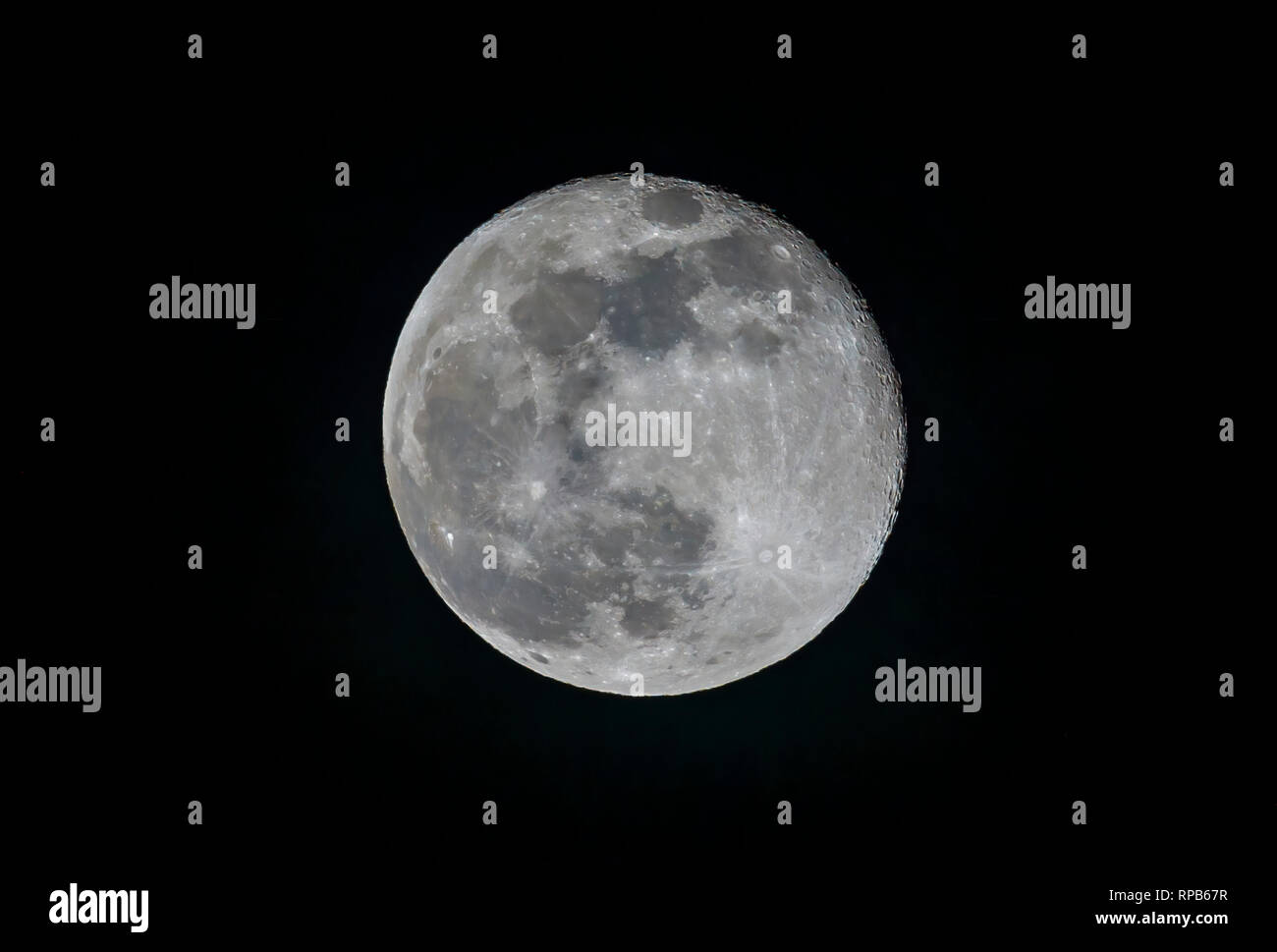 Celestial body in the heavens: Waning gibbous Moon (one day after full moon) in the night sky seen from Surrey, south-east England, UK - Stock Image