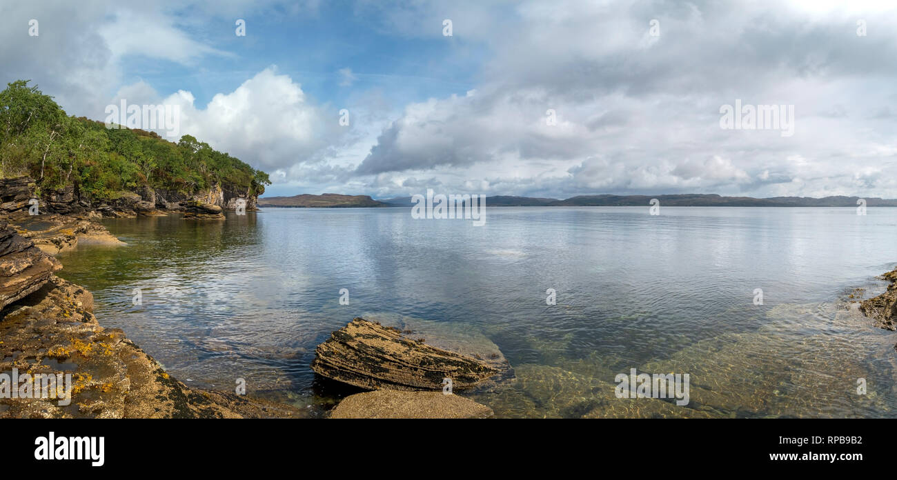 Panoramic view of calm waters of Loch Slapin and Loch Eishort, cliffs and coastal scenery near Elgol on the beautiful Island of Skye, Scotland, UK - Stock Image