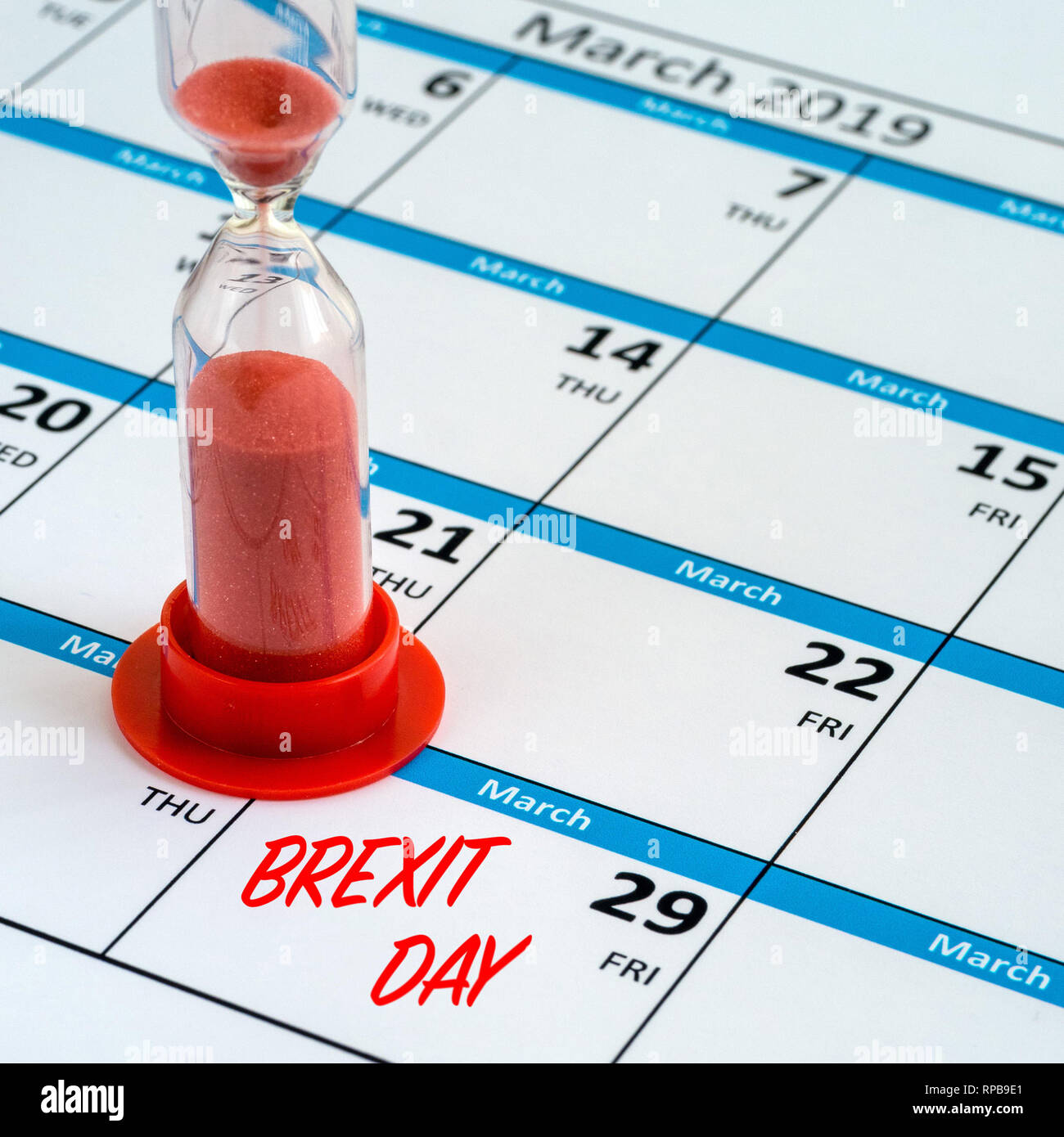 Concept image of time running out, or running down the clock to Brexit day deadline on 29th March 2019 shown by a calendar and hourglass timer. - Stock Image