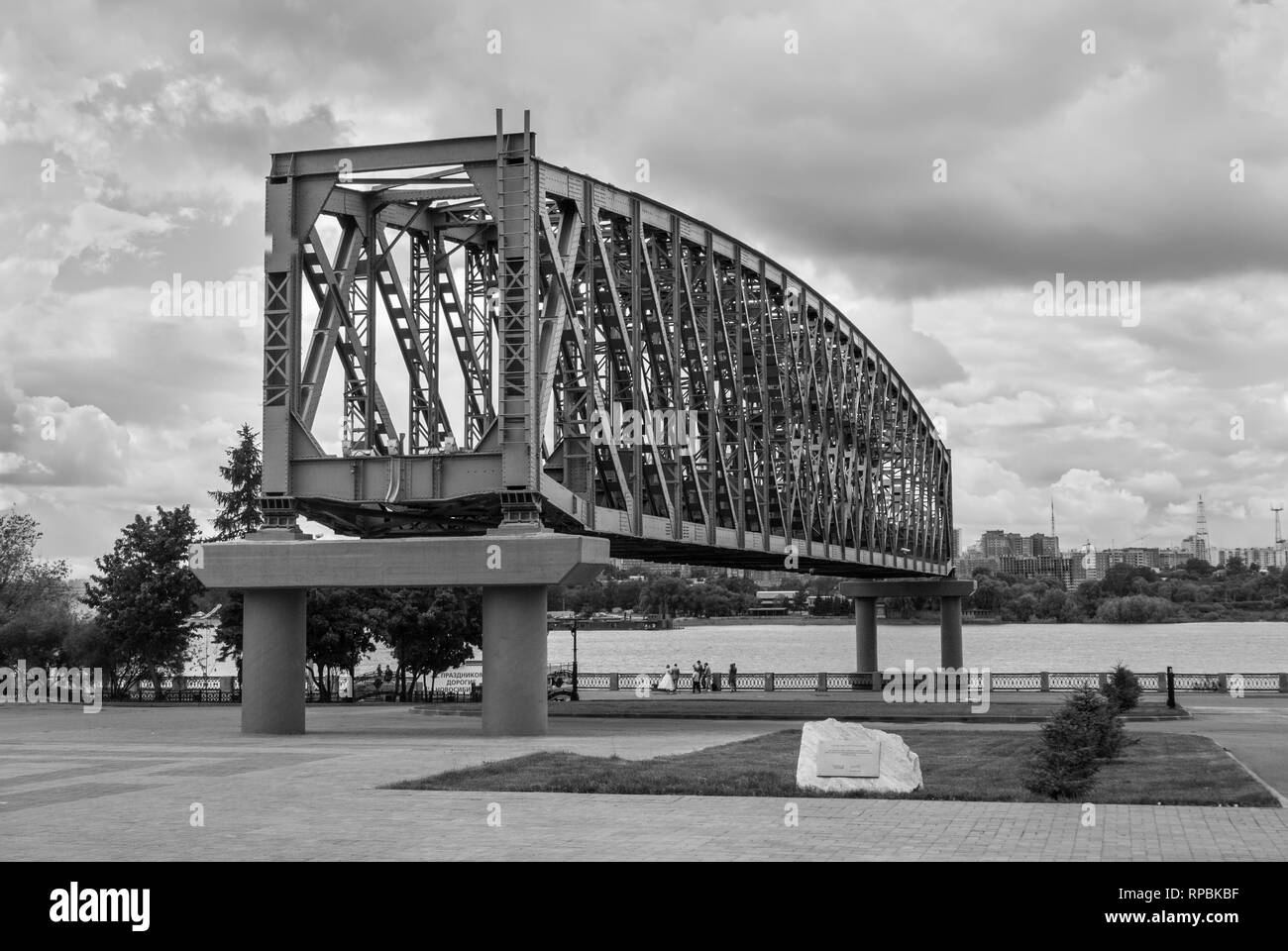 Novosibirsk, Russia - June 28, 2013: The part of railroad bridge on alley '120 years of Transsib'. Black and white photography. - Stock Image