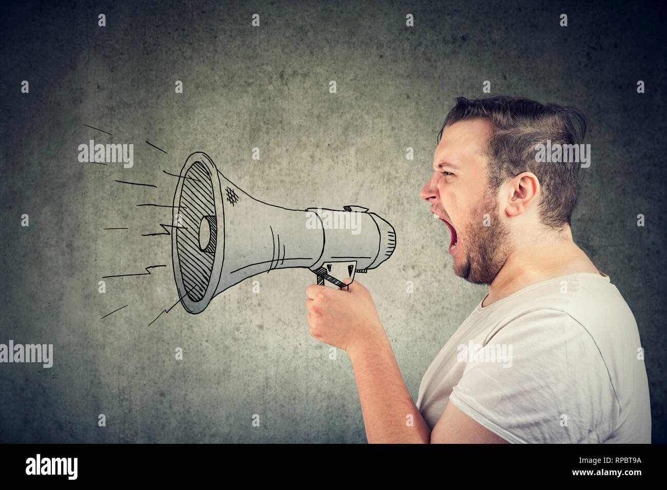 Young man screaming in loudspeaker making an announcement - Stock Image