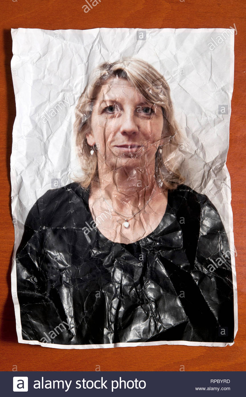 portrait photo of a blond woman crumpled and wrinkled, ageing concept - Stock Image