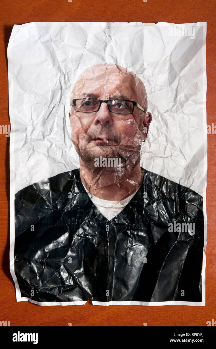 portrait photo of a bald man with eyeglasses crumpled and wrinkled, ageing concept Stock Photo