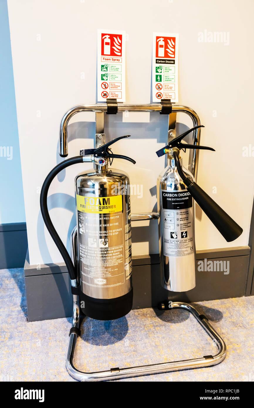 Fire extinguishers, fire extinguisher, foam extinguisher, carbon dioxide fire extinguisher, foam fire extinguisher, carbon dioxide extinguisher, - Stock Image