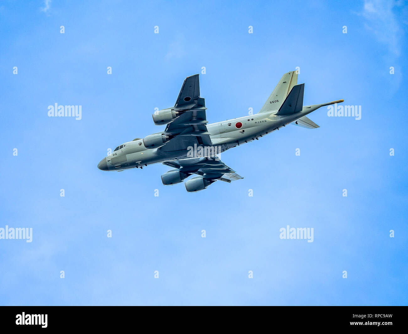 A Japanese Maritime Self Defense Force (JMSDF) Kawasaki P-1 Maritime Patrol Aircraft flies low near the Atsugi Air Station in Kanagawa Prefecture, Jap Stock Photo