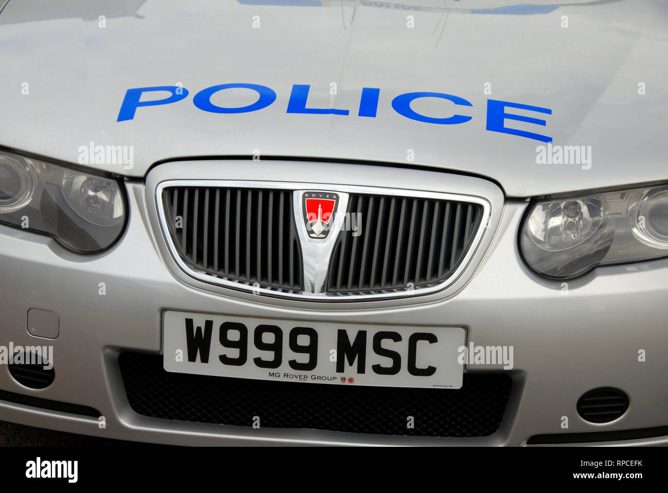 Police car with the number 999 in its registration plate - Stock Image