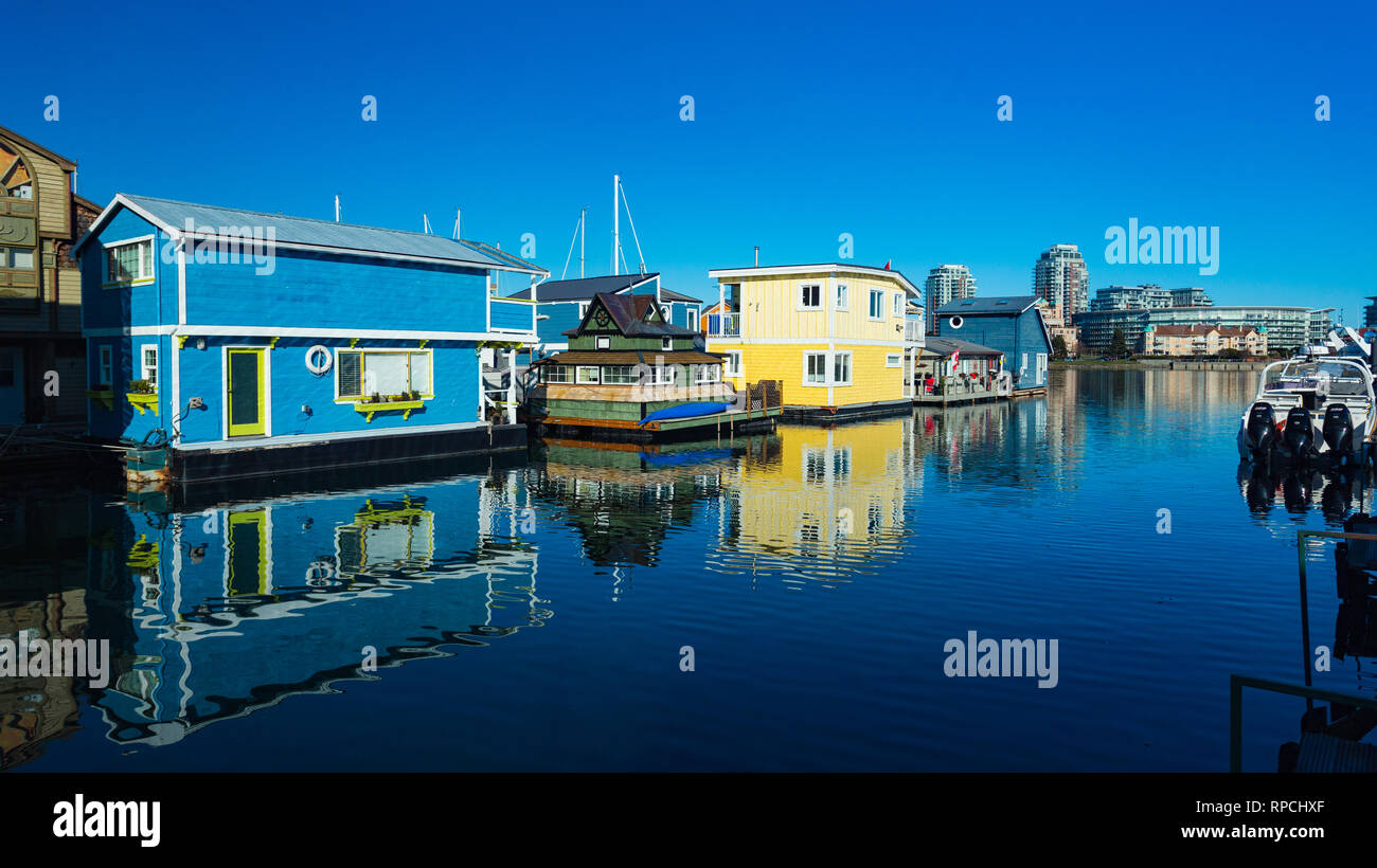 Floating Home Village Houseboats Fisherman's Wharf Inner Harbor, Victoria British Columbia Canada.Area has floating homes, boats, piers, restaurants a - Stock Image