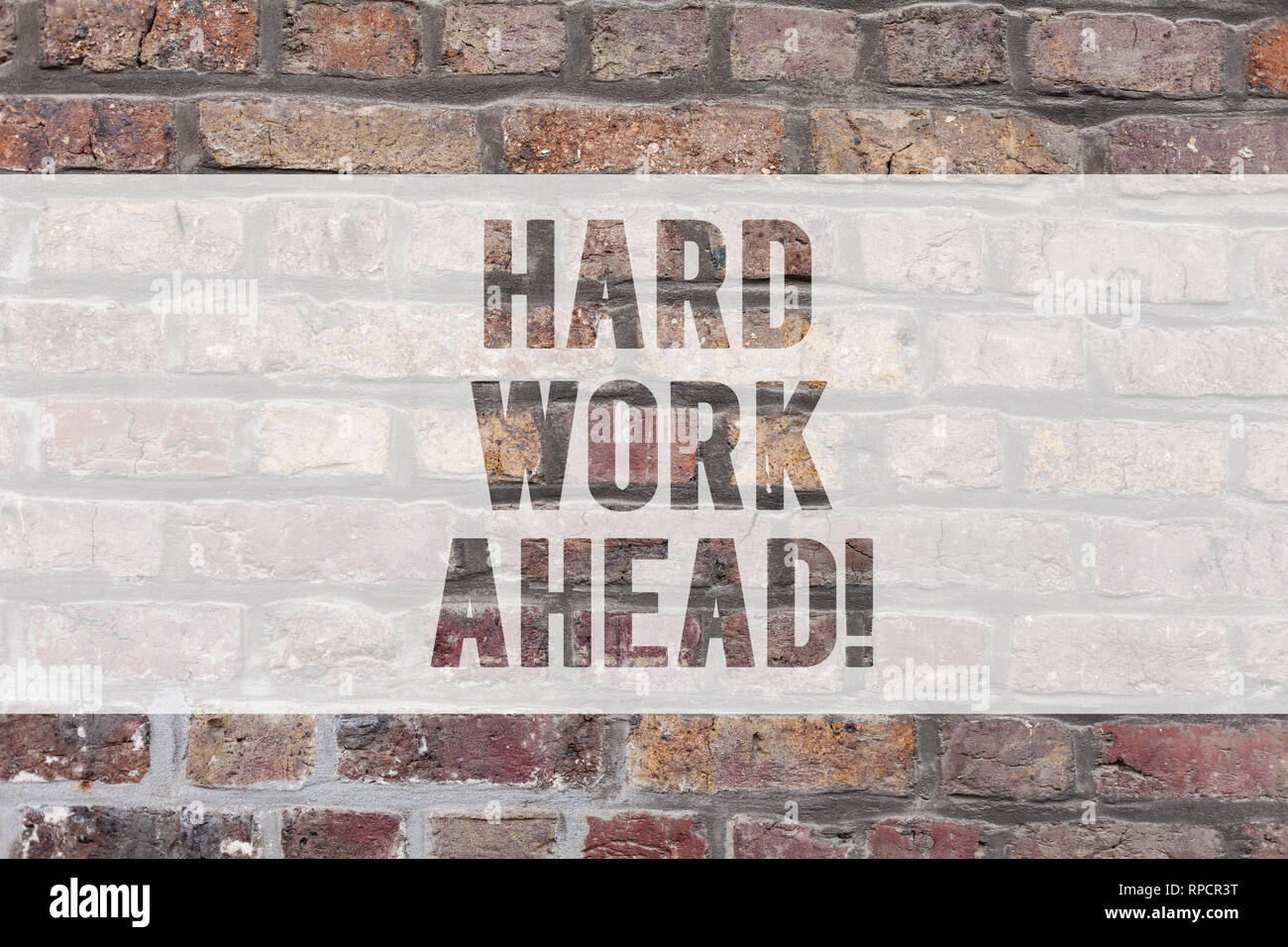 Writing note showing Hard Work Ahead. Business photo showcasing A lot of job expected big challenge activities required Brick Wall art like Graffiti m - Stock Image