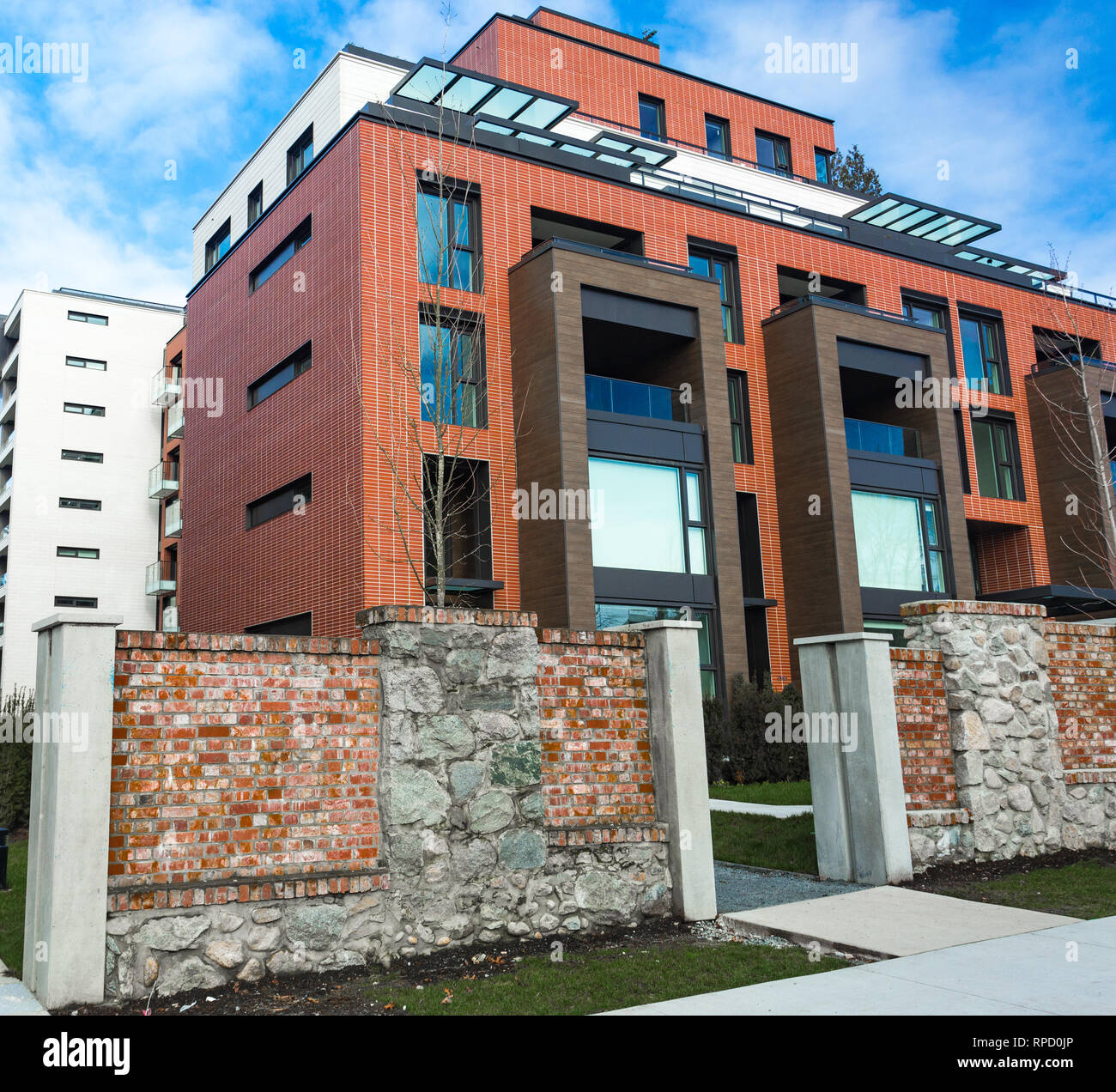 Low angle view on modern residential brick apartment ...