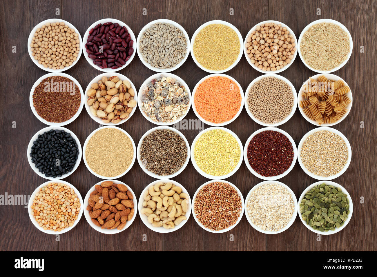 Dried vegan health food with  grains, nuts, seeds, sos mix, cereals, wholegrain pasta and legumes. Stock Photo