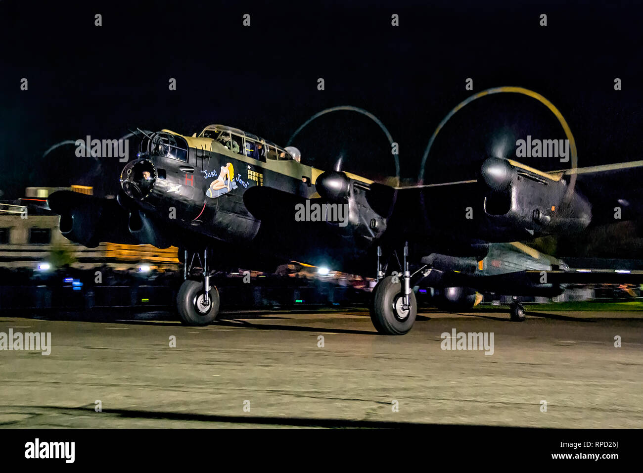 Lancaster 'Just Jane' does a night taxy run at the Lincolnshire Aviation Heritage Centre, East Kirkby in November 2014. - Stock Image