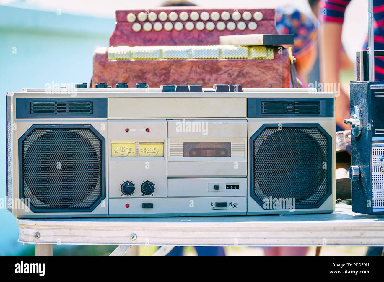 Old cassette recorder of silver color on table - Stock Image