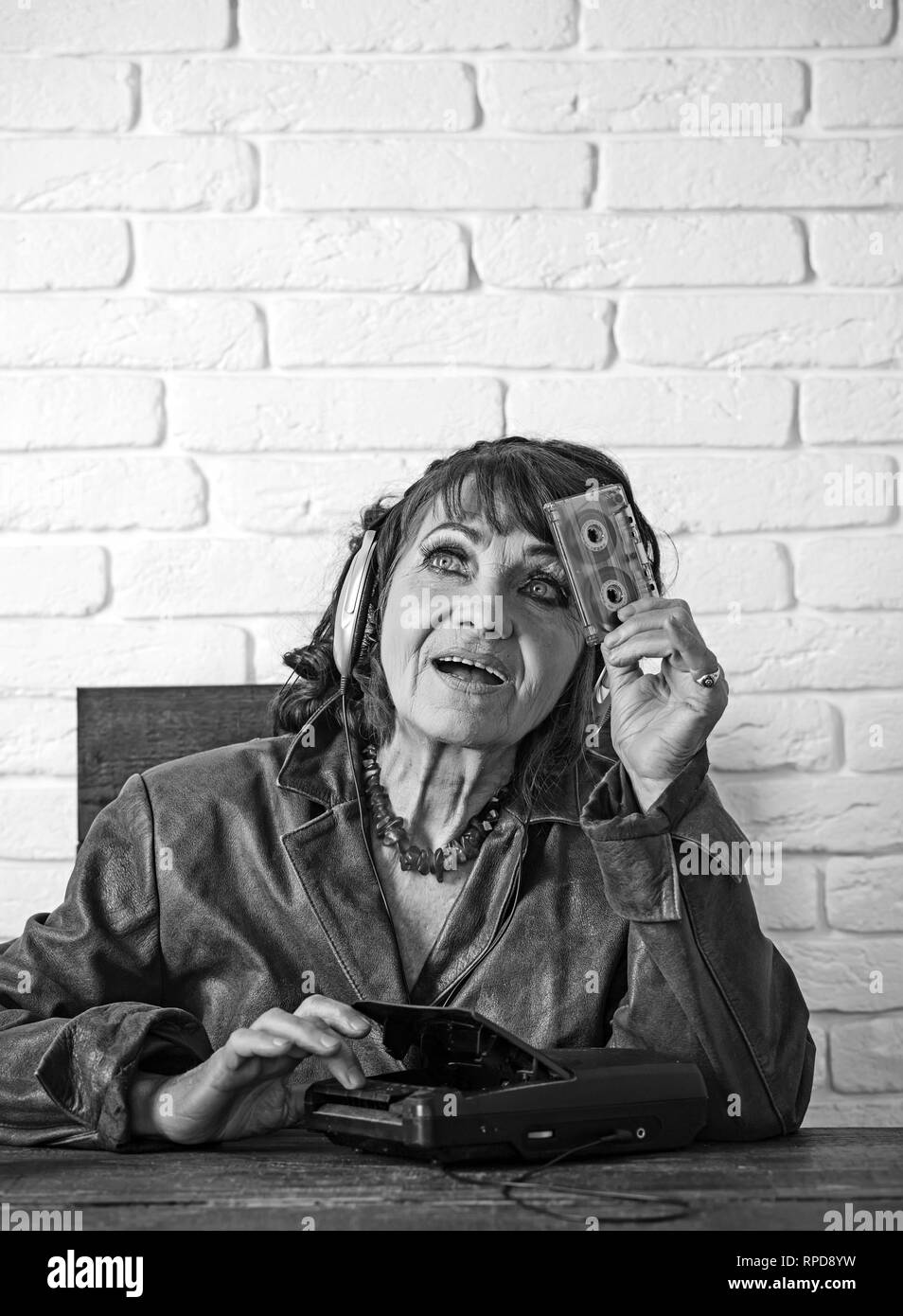 happy granny dj in headset with cassette player. - Stock Image