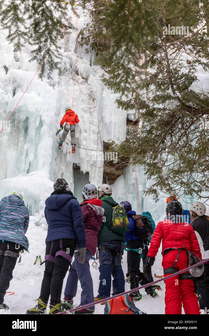 Munising, Michigan - Participants in the annual Michigan Ice Fest climb frozen ice formations in Pictured Rocks National Lakeshore. - Stock Image