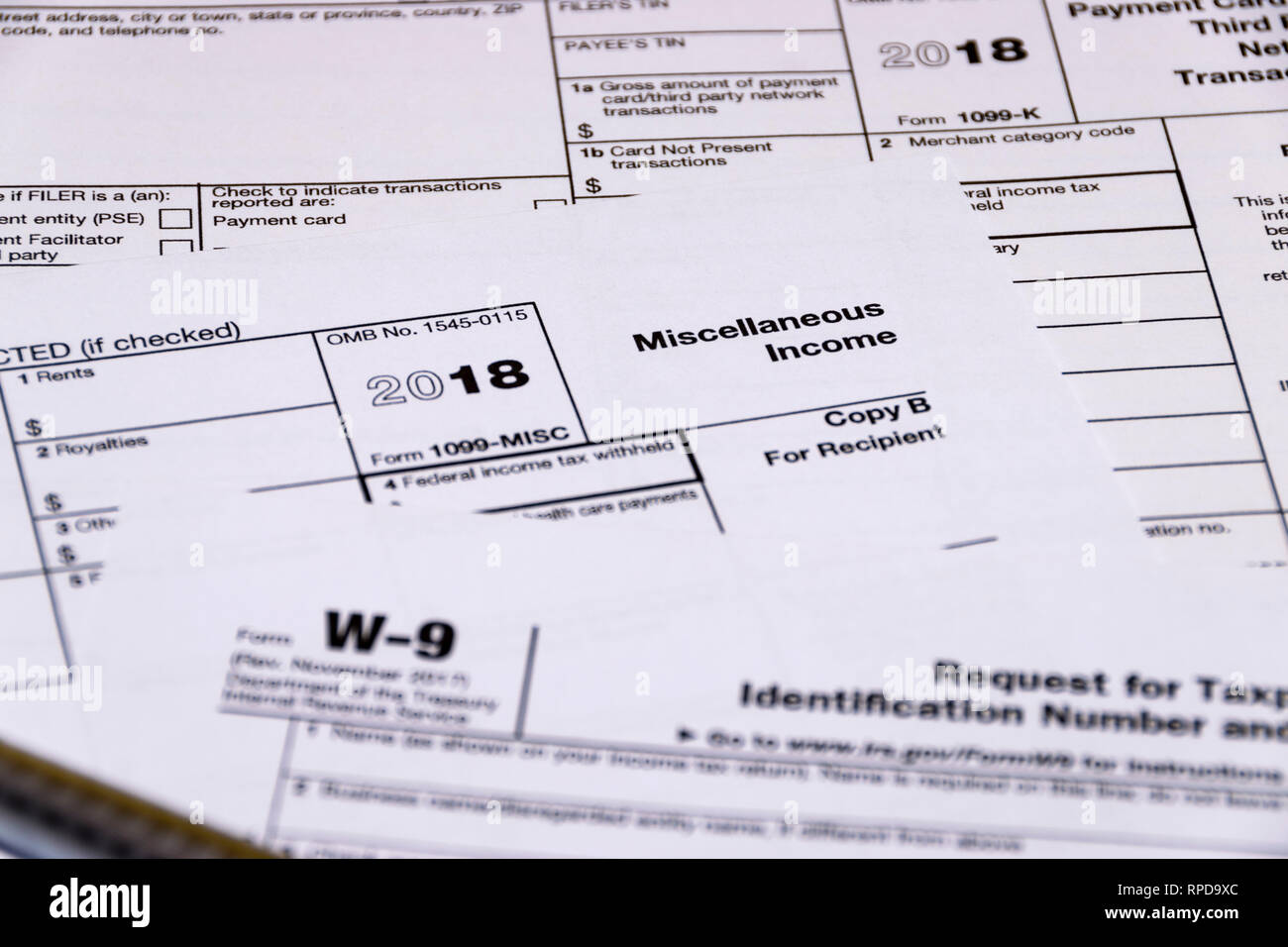 Composed shot of IRS tax forms 1099-MISC, 1099-K and W-9. - Stock Image
