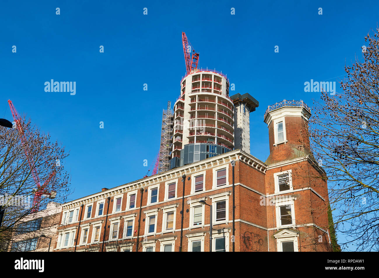 The new City North residential development under construction in Finsbury Park, viewed from Fonthill Road, North London UK - Stock Image