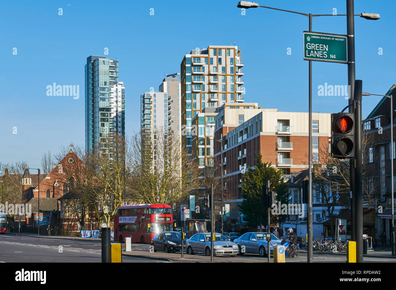 New apartment buildings at Woodberry Down, looking down Seven Sisters Road from Manor House, North London UK - Stock Image