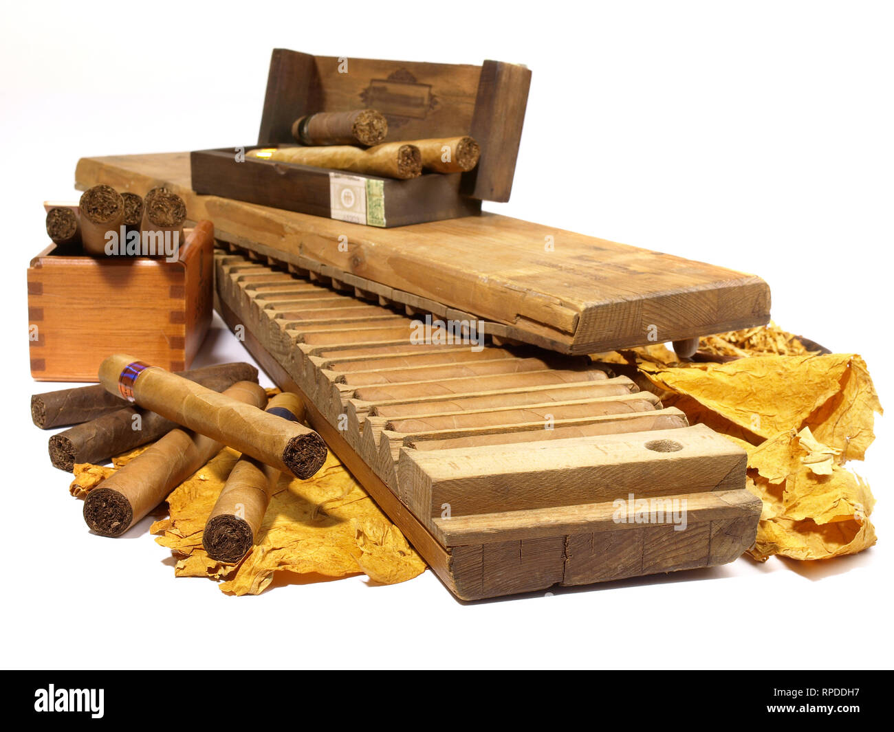 Cigars with Press and Tobacco Leaves on white Background - Stock Image
