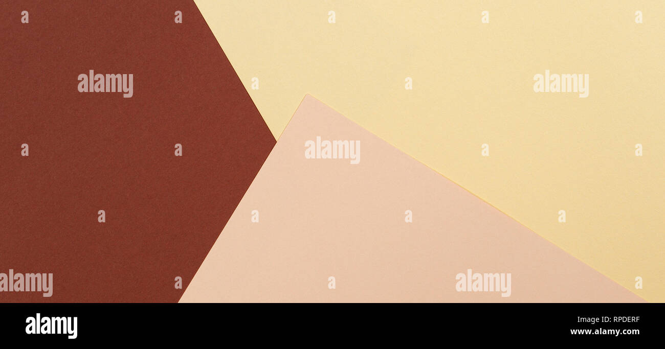 Color papers geometry composition background with yellow beige and brown tones - Stock Image