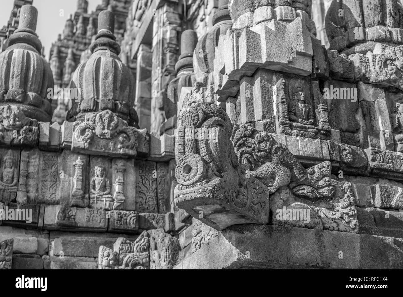 Gargoyle at Candi Siwa (Shiva Temple) in Prambanan temple complex. 9th century Hindu temple compound located near Yogyakarta on Central Java, Indonesi - Stock Image