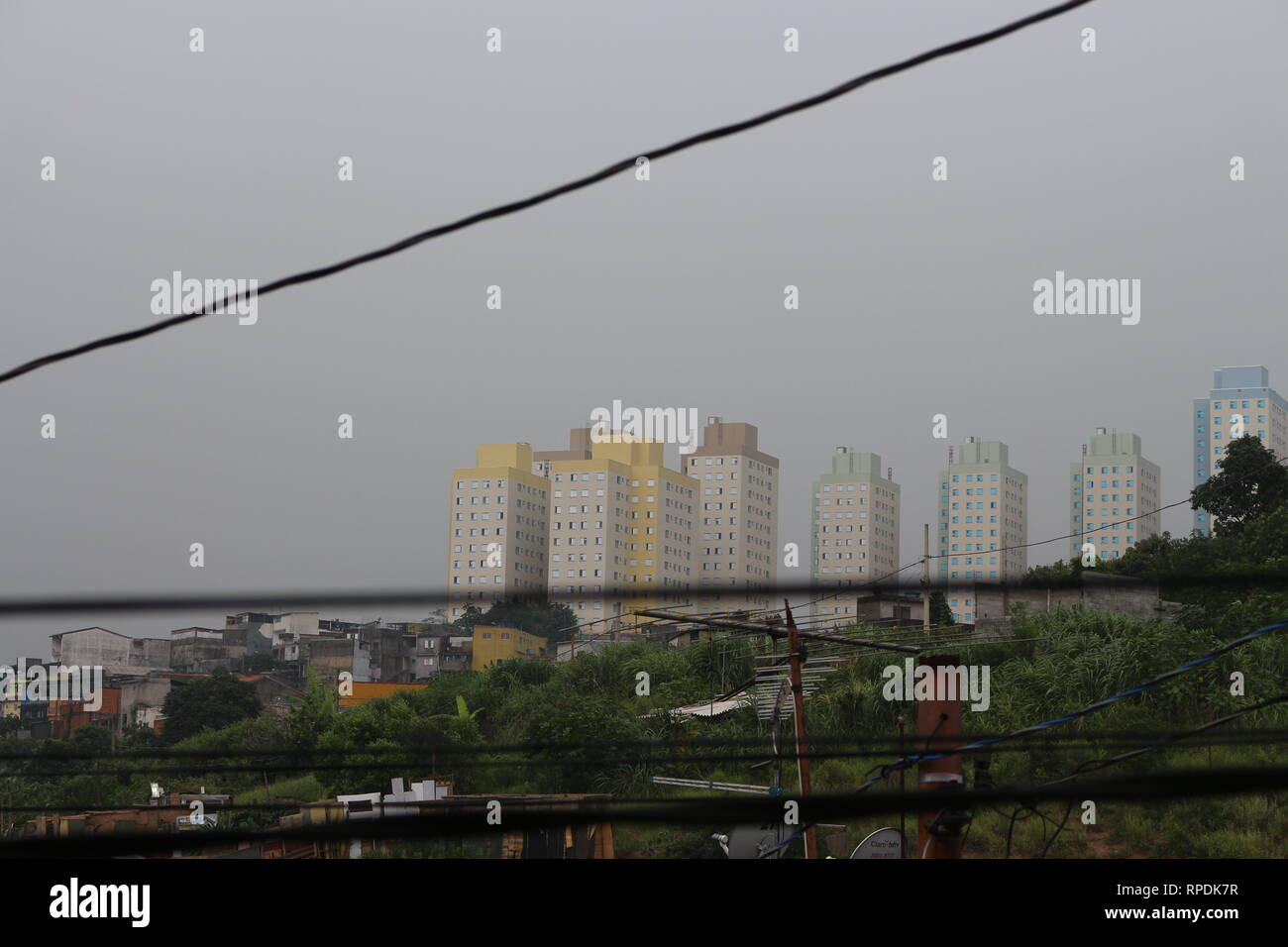 Urban landscape of a rainy and cloudy day seen from a window. Stock Photo