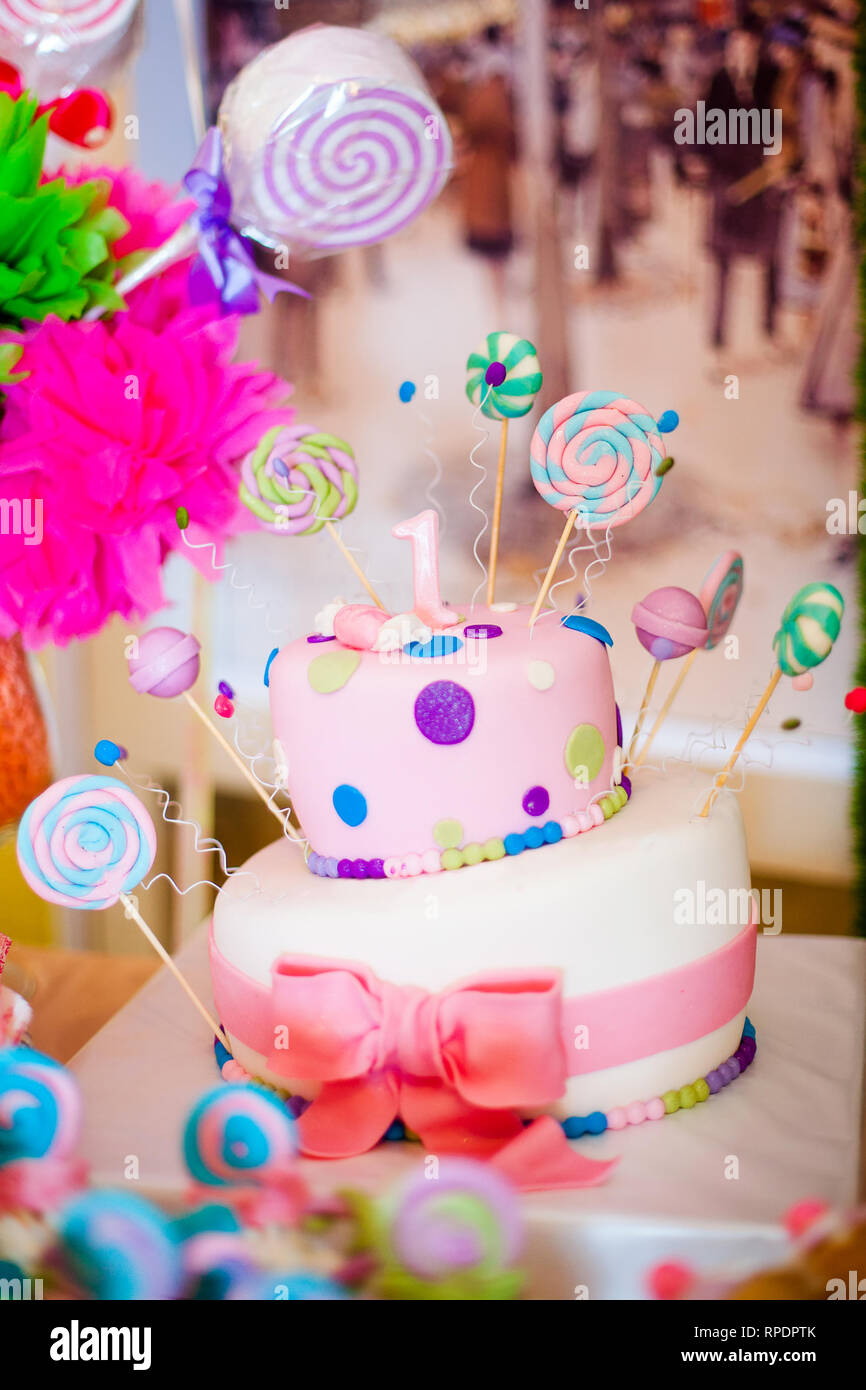 Astonishing First Birthday Pink Cake With Lollypops And One Candle For Little Funny Birthday Cards Online Alyptdamsfinfo