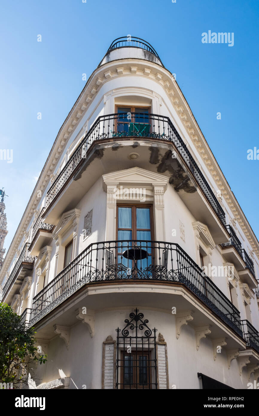 Acute angle corner building in the spanish city of Seville - Stock Image