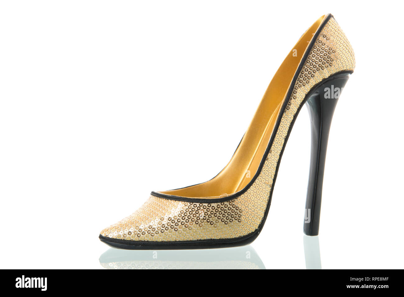 b872cda4cd Golden high heel shoe with stiletto heels isolated over white background -  Stock Image
