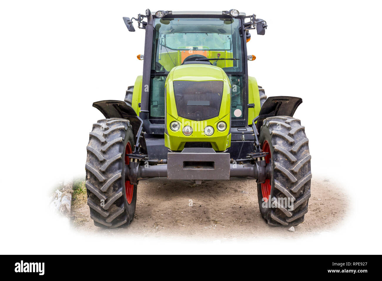 Powerful tractor for various agricultural work. Front view of an agricultural machine. Necessary equipment for a dairy farm. The isolated image. - Stock Image