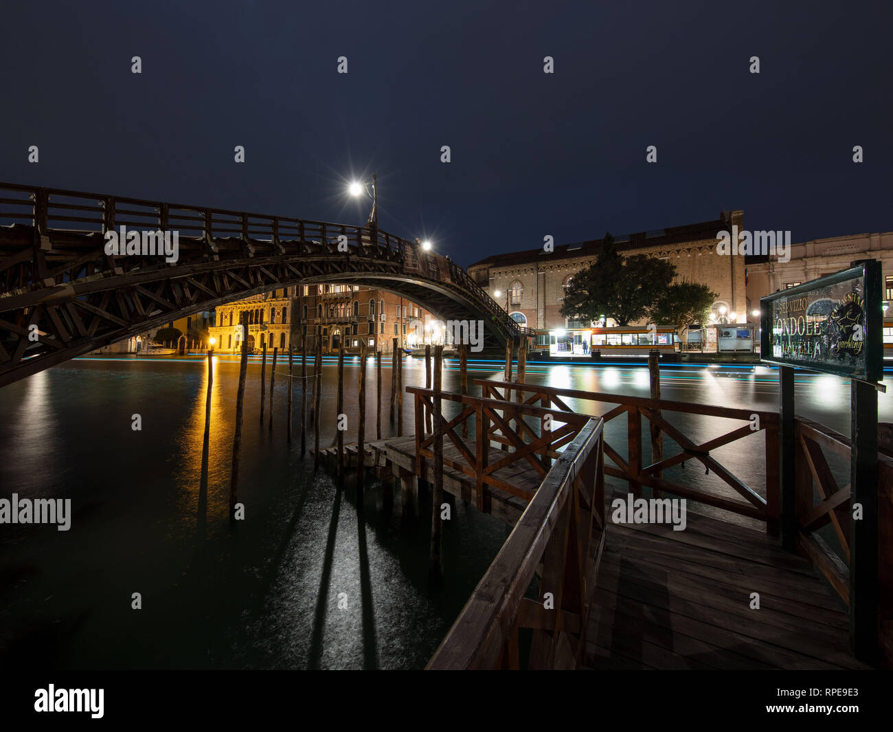 A beautiful shot of a Gondola Station in Venice, Italy. Looking over towards the Academia Bridge late one evening. - Stock Image