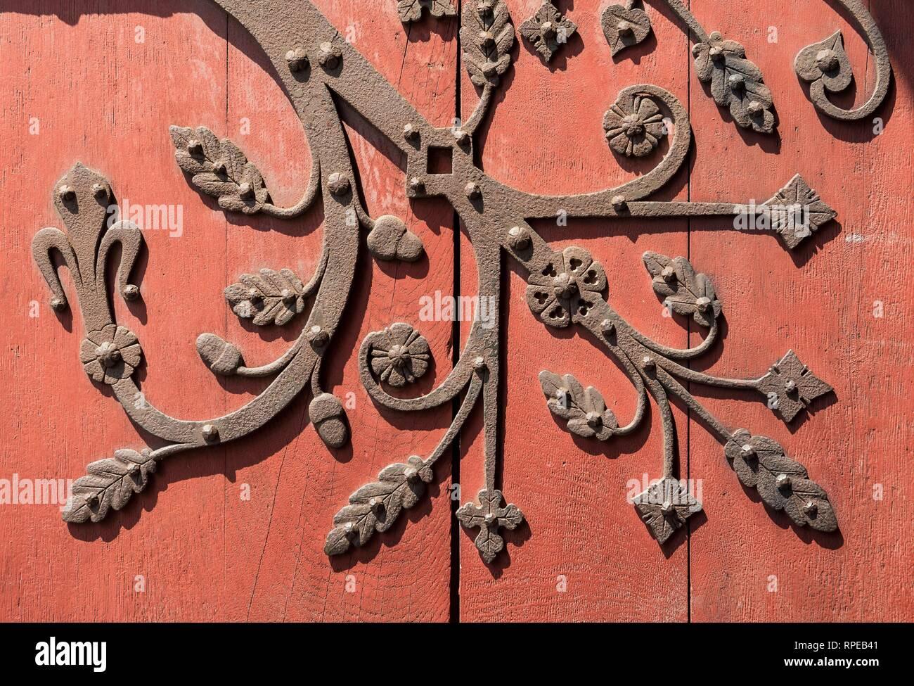 Ornate metal fittings on wooden door, Strasbourg, France Stock Photo