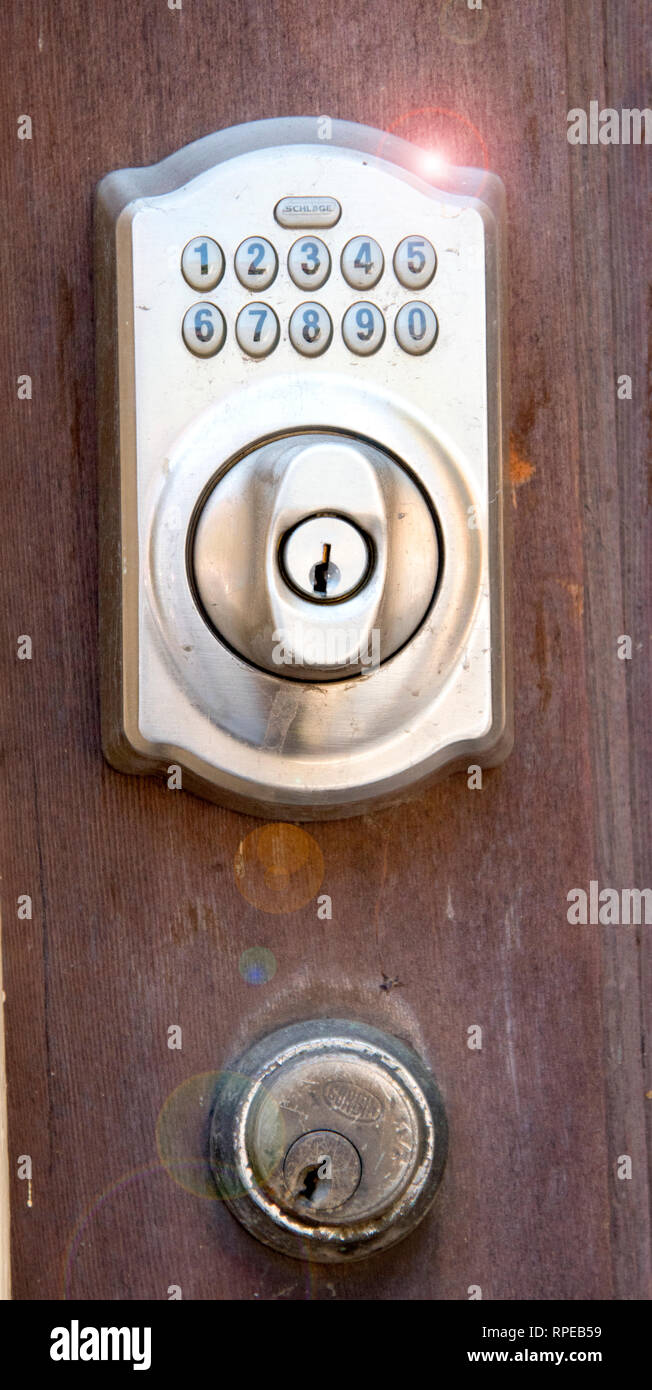 Old and New, Yesterday and Today, Visual Metaphor, Door Locks - Stock Image