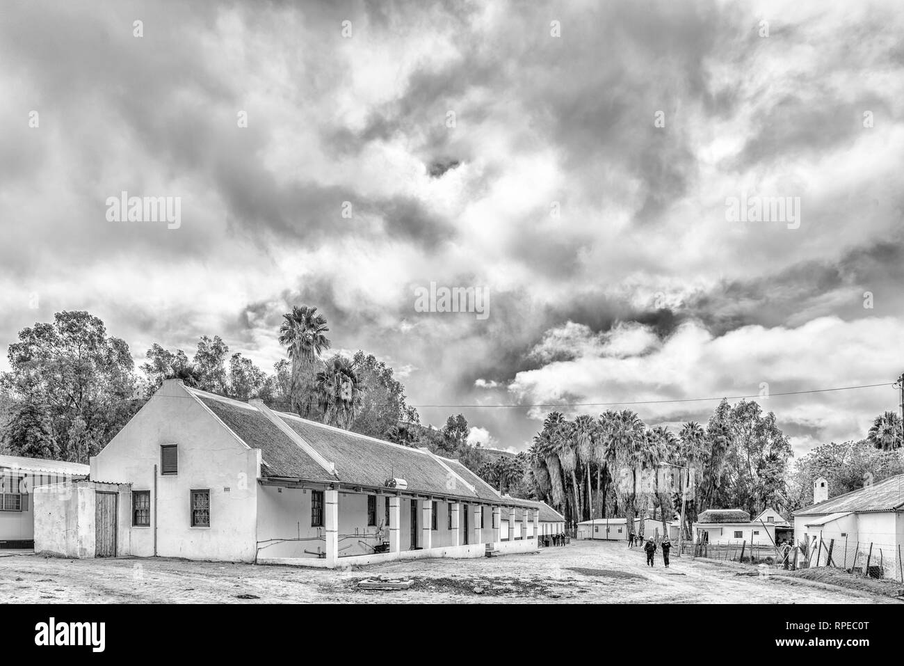 WUPPERTHAL, SOUTH AFRICA, AUGUST 27, 2018: A street scene, with historic buildings and people, in Wupperthal in the Cederberg Mountains of the Western - Stock Image